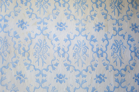 Old blue classic Slavic paint pattern on white dirty wall