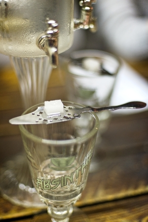 Classic ritual of glass of absinth and dripping fountain. Stock Photo