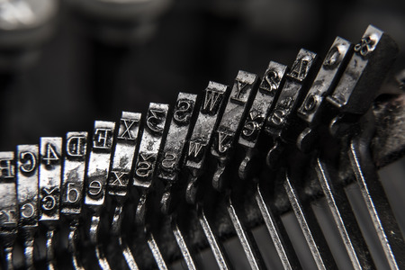 Old classical metal typewriter with ink on letters. Stock Photo