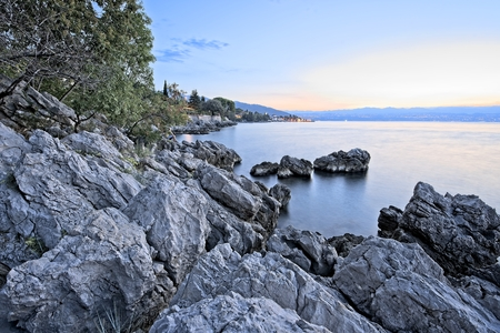 Rock shore of east Istria, Croatia in the morning just before sunrise. North direction towards Rijeka bay. Archivio Fotografico - 115168169