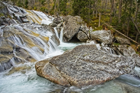 Cold Creak waterfalls in High Tatras mountains. Smooth water trails of Long Waterfall. Archivio Fotografico - 115168776