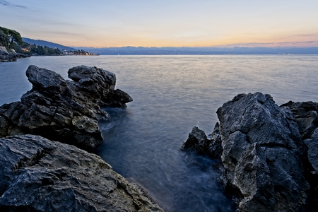 Rock shore of east Istria, Croatia in the morning just before sunrise. North direction towards Rijeka bay. Archivio Fotografico - 115168782