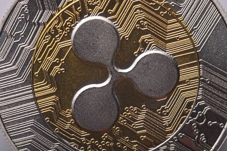 Macro of shining gold and silver metal XRP Ripple virtual currency coin