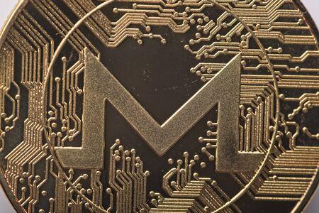 Macro of shining gold metal Monero virtual currency coin