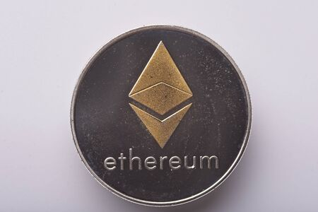 Shining gold and silver metal ETH Ethereum virtual currency coin on white background Zdjęcie Seryjne - 129330853