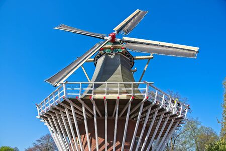 Traditional dutch windmill, front view from low angle with clear blue sky. Stockfoto