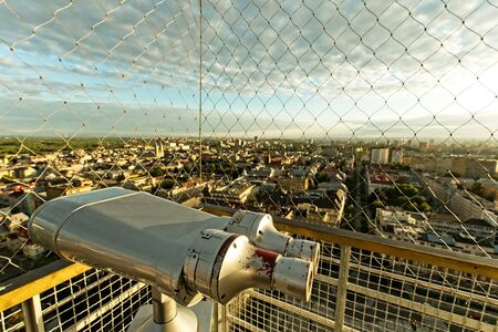 Evening Ostrava city from above from town hall tower. Cage and binoculars on the top of city hall tower. Stockfoto