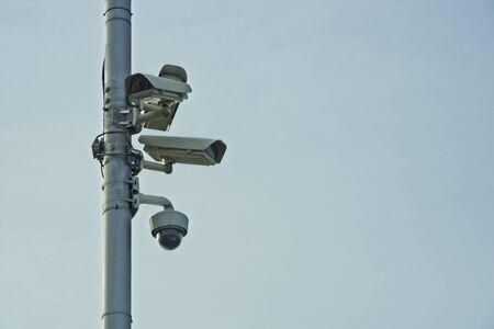 Lot of CCTV cameras on metal pole. Stock fotó