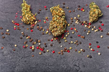 Cannabis buds with pepper. Caryophyllene terpene concept on grey background.