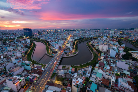 loc: Aerial sunset view of houses and Business and Administrative Center of Ho Chi Minh city on NHIEU LOC canal