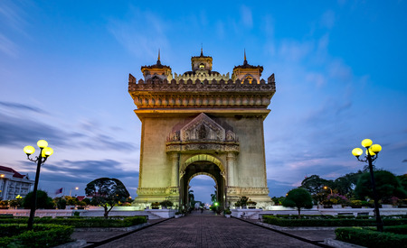 independance: Patuxay monument is dedicated to the deads during the Independance war from France, shot during the blue hour in Vientiane, the capital city of Laos. Stock Photo