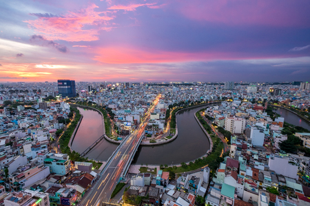 Aerial sunshine view of rooftop skyscraper on Nhieu Loc canal in Ho Chi Minh city, Vietnam Stock Photo