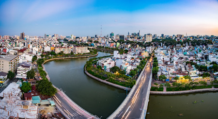 HOCHIMINH CITY, VIETNAM - OCTOBER 19, 2015: Parkview aerials of houses and Business and Administrative Center of Ho Chi Minh (SAIGON) city on NHIEU LOC canal Editorial