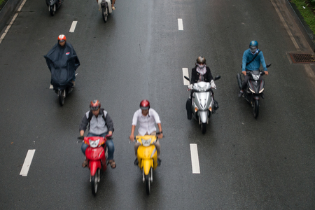 HO CHI MINH, VIETNAM - MAY 11 2017: Motorcycle traffic in rain. Is located in the South of Vietnam, is the countrys largest city, population 8 million