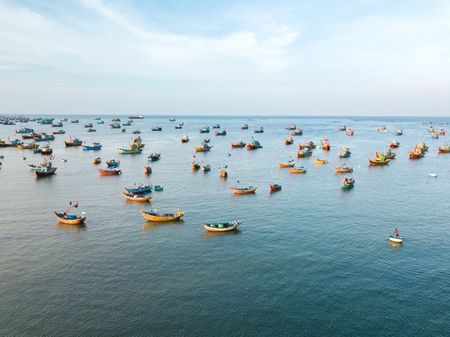 Top view, aerial view fishing harbor market from drone. Mui Ne fishing harbor or fishing village. Fishing harbor is a popular tourist destination