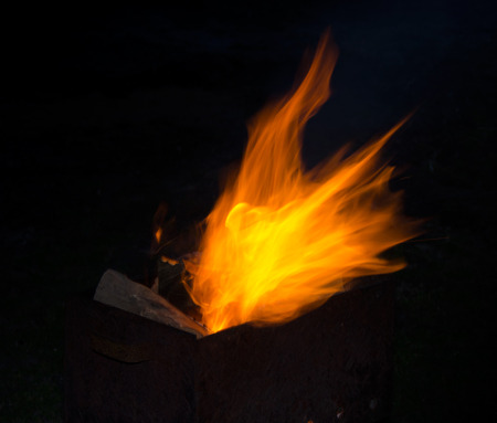 summer sport: Fire in grill in the summer night