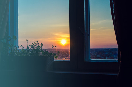 open windows: View on beautiful sunrise from home window