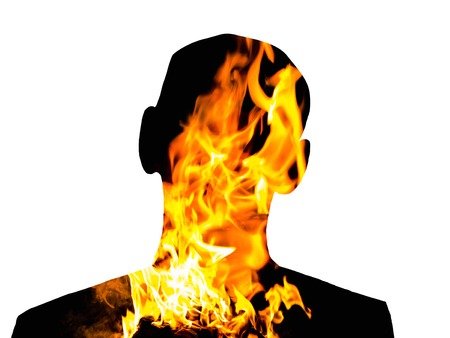 unnamed: Unknown black man silhouette with double exposure effect of fire on the white isolated background