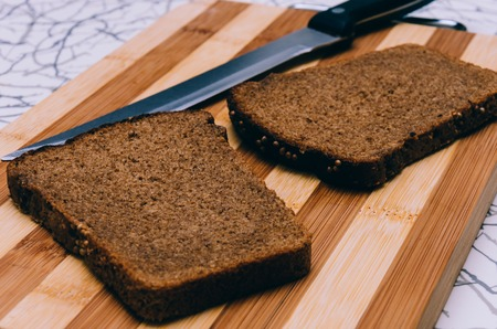 healthy product: Photo of the bread and knife with selective focus
