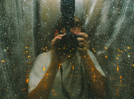 multiple ethnicities: Photo with double exposure effect of the photographer and rain drops