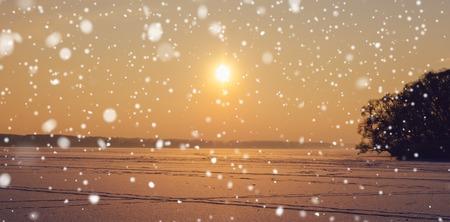beautifu: beautifu sunset on the frozen lake in winter snowfall time Stock Photo