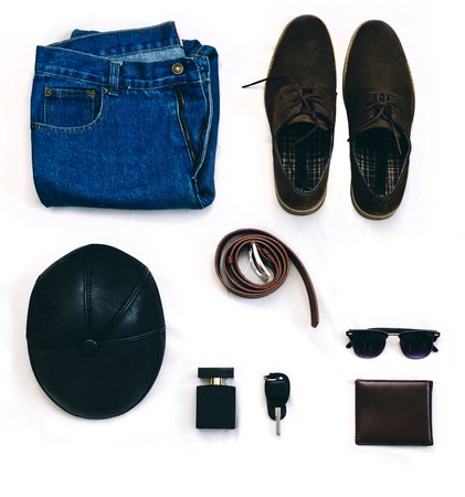 suede belt: Outfit of clothes young man with vintage blue jeans, grew shirt, brown suede shoes, clubmaster sunglasses, purse and other on the white background