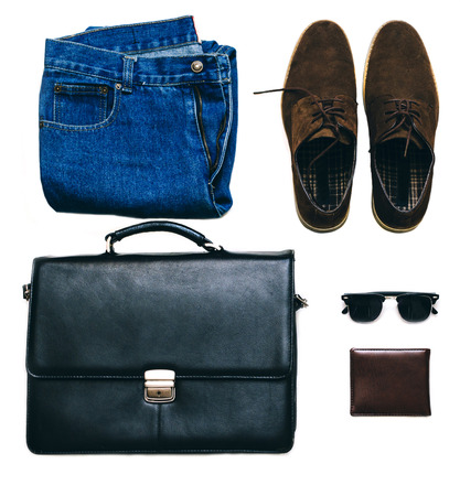 black briefcase: Outfit of business man with vintage blue jeans, black briefcase, brown suede shoes, clubmaster sunglasses and purse on the white isolated background