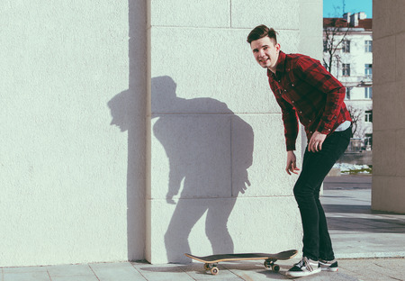 halfpipe: Young man on the city street with skateboard