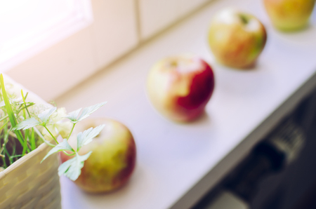 Apples on the home window with selective focus and soft sun light