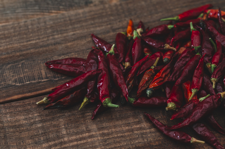 Red dry hot chili pepper on the wooden rustic background Stock Photo