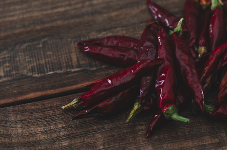 Red dry hot chili pepper on the wood rustic background Stock Photo