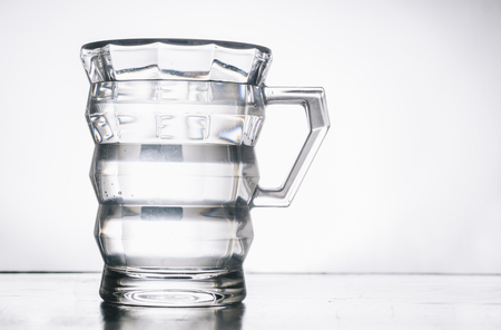 Glass with water or other drink on table