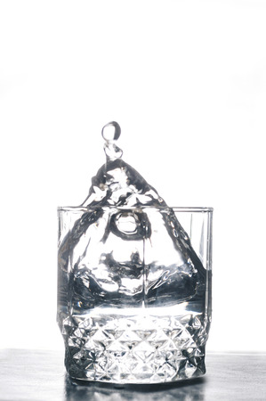 Glass of water on the white isolated background