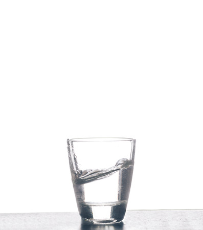 Glass with water on the white background