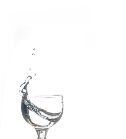 Glass with water on the white isolated background Stok Fotoğraf