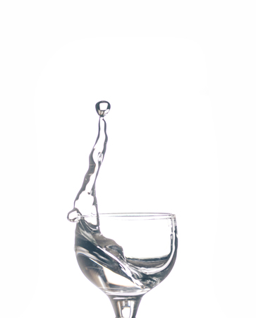 Glass with water on the white isolated background Imagens
