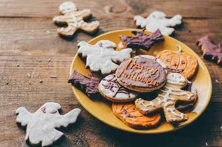 Halloween cookies on home kitchen rustic table