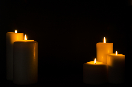 Fire candle on dark black background Stock Photo