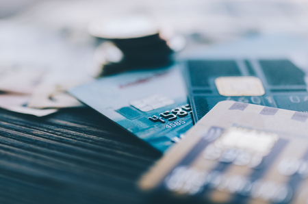 Credit card, coins and money on the table Archivio Fotografico