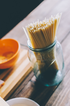 Ingredients for Pasta on home wooden table