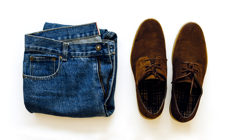 Collage of vintage men's jeans and shoes on a white isolated background 스톡 콘텐츠