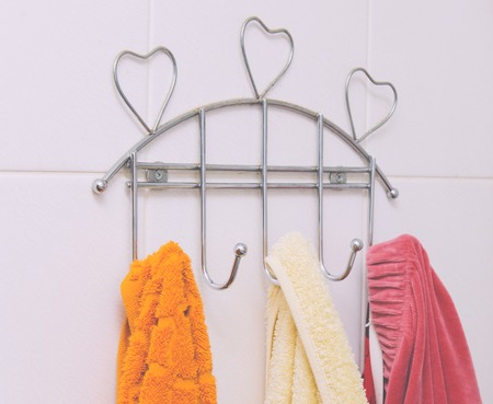 Color textile towels in the home bathroom Stock Photo