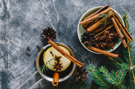 Christmas mulled wine in bowl on home table Stock Photo