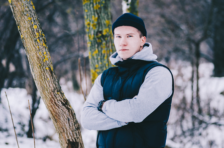 Portarit of the young man in winter park Stock Photo