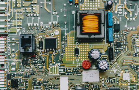 Detail of an electronic printed circuit board with many electrical components Stock fotó