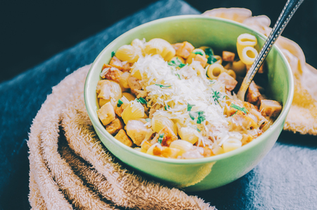 pasta carbonara in green bowl on table Stock Photo