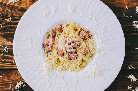 Tasty pasta carbonara on home kitchen wooden rustic table