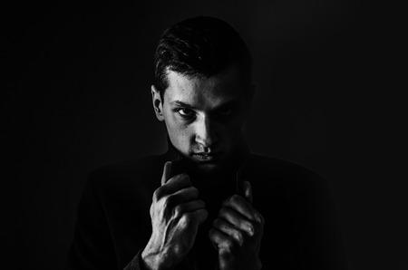 Man in black coat, monochrome photo Stockfoto