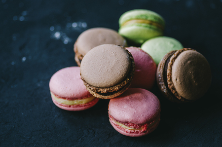Close up colorful macarons dessert with vintage pastel tones Stockfoto