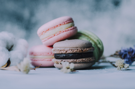 Colorful macarons on gray marble background. Pastel colors